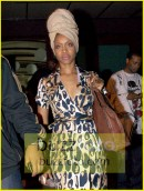 EXCLUSIVE: ERYKAH BADU came out looking a bit grumpy to be photographed by a 14 year old paparazzo in front of Koi Restaurant in West Hollywood, CA