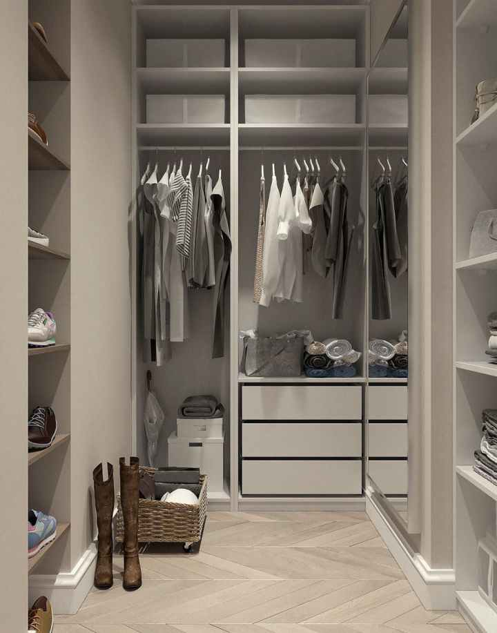 assorted clothes hanged inside cabinet