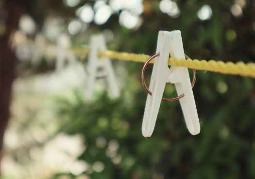 rope with clothespins hanging on laundry string