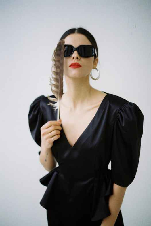 fashionable woman in trendy outfit with sunglasses