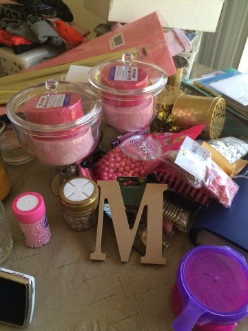 "jars, candy, sprinkles, tissue paper, and the ""M"""