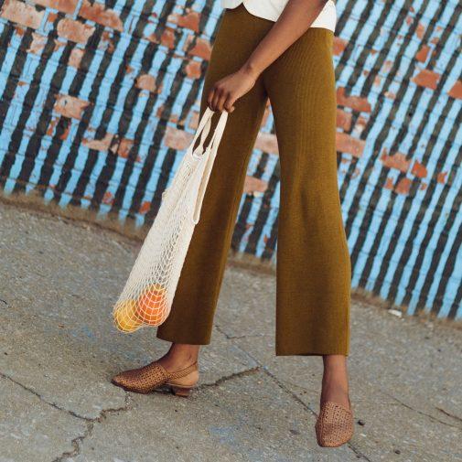 Detail shot of knit pants, shoes and  bag