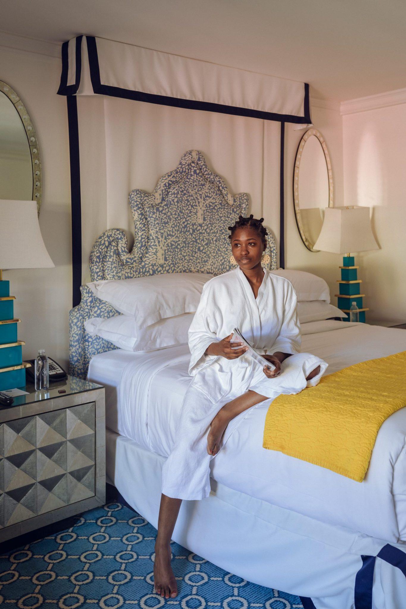 Black Women Sitting on Bed