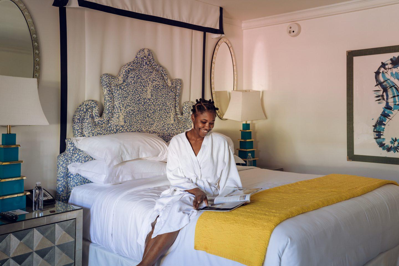 Black Female Sitting on Bed