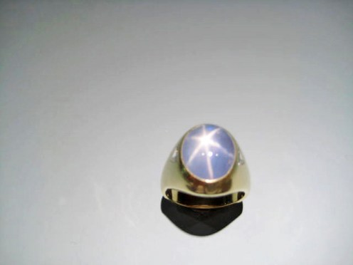 18K Gold Ring with Star of sapphire and Diamond Artist: Frank Catalog: 334-90-1 # 18752 Price: $16,800.00 REDUCED: $7000.00