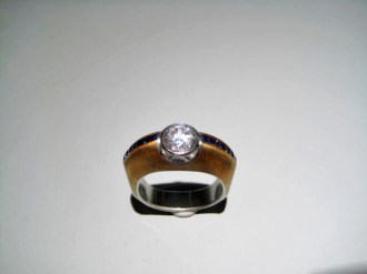 Platinum and 18K Gold Ring with .33c Sapphire and C.Z. Artist: David Zoltan Catalog: 613-04-5