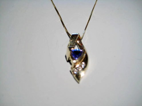 14K Gold Pendant and Chain with .70c Tanzanite and Diamond Artist: M. Rogers Catalog: 801-42-4