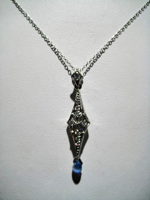 Platinum Necklace with .20c Diamond and Sapphire Artist: Varna Catalog: 105-5-9