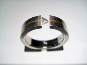 Platinum and 18K Gold Ring with .18c Diamond Artist: Steve Kretchmer Catalog: 902-56-4