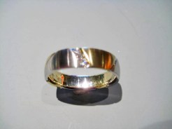 Platinum and 18K Gold Band with .09c Diamond Artist: Mark Michaels