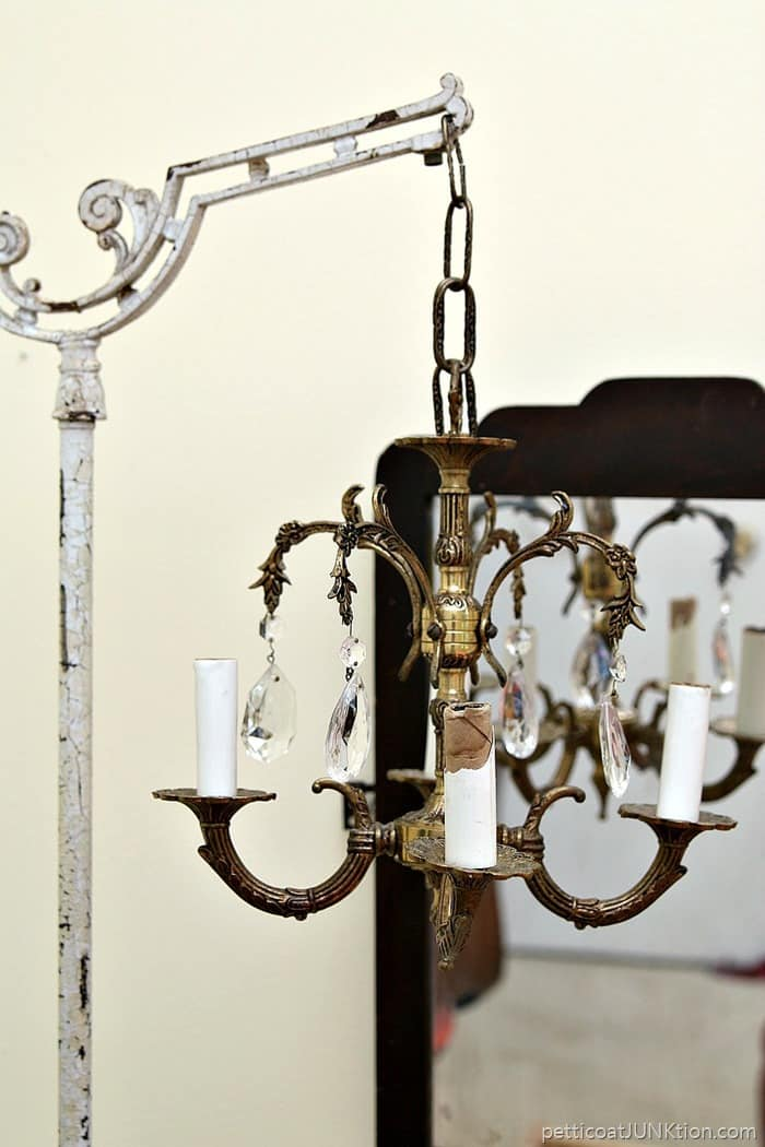 Junk Chandelier Swings From Antique Lamp Stand Petticoat