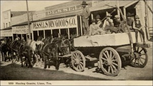 A wagon hauls a slab of granite through the streets of Llano in this undated postcard photo.