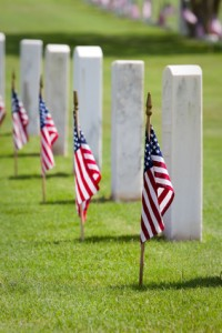American flags on gravesites commemorate Memorial Day at at United States national cemetery.