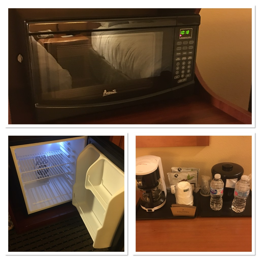 Photo of microwave, mini fridge and coffee selection available in a standard room at Country Inn and Suites