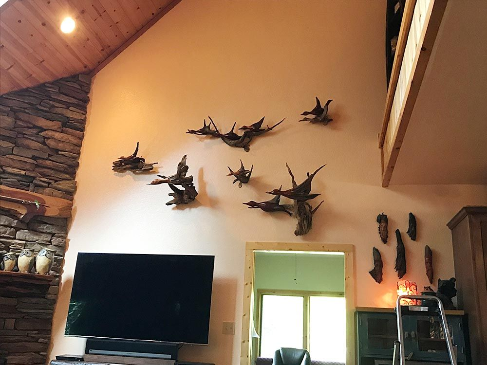 wall full of duck carvings