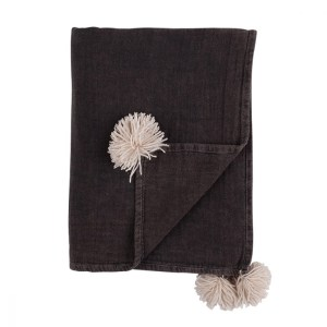 Black throw with white pom pom