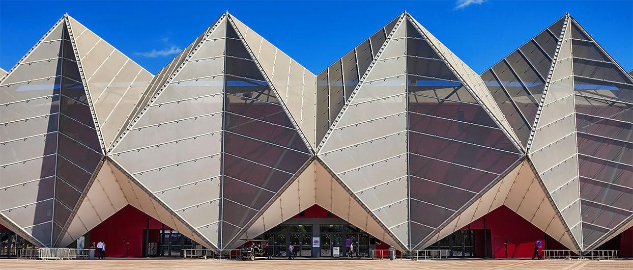 tensile membrane façade versus metal mesh façade