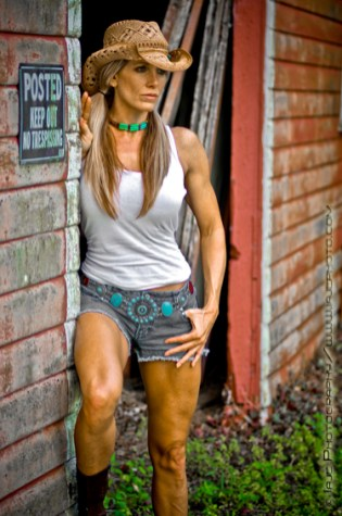 Fit cowgirl at the farm. Fitness modeling.