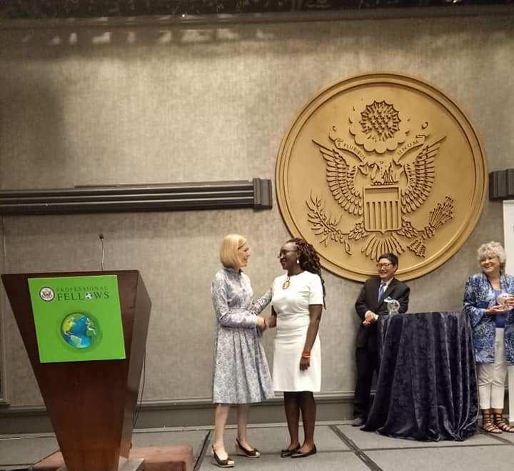 Maria accepting award