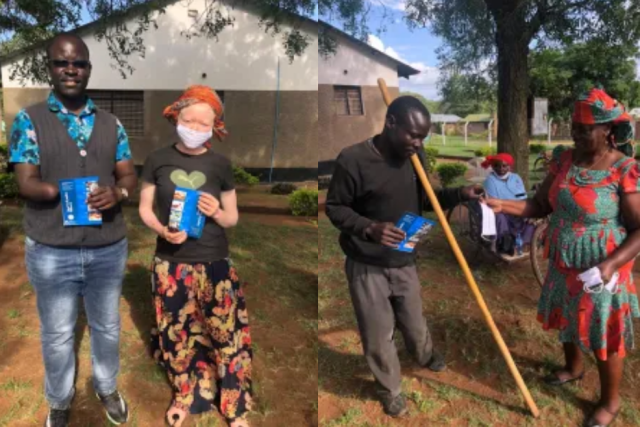 Archy and SARDO colleagues distribute hand-washing flyers to persons with disabilities in Shirati, Tanzania.