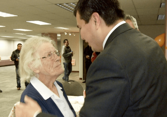 With a tear in her eye, long-time NDP supporter Joy McKellar greets Cariboo-Prince George NDP candidate Trent Derrick shortly before he concedes defeat Monday night.