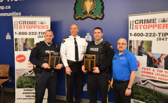 Cpl. Peter Rauliuk (accepting the Watch of the Year award), Supt. Warren Brown, Clonst. Derek Rondeau, and Prince George Crime Stoppers President Ron Polillo.