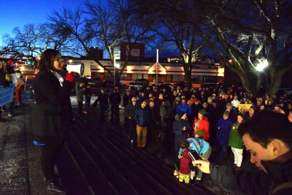 HIra Rashid addresses the crowd at a vigil in support of the Muslim community Monday. Bill Phillips photo