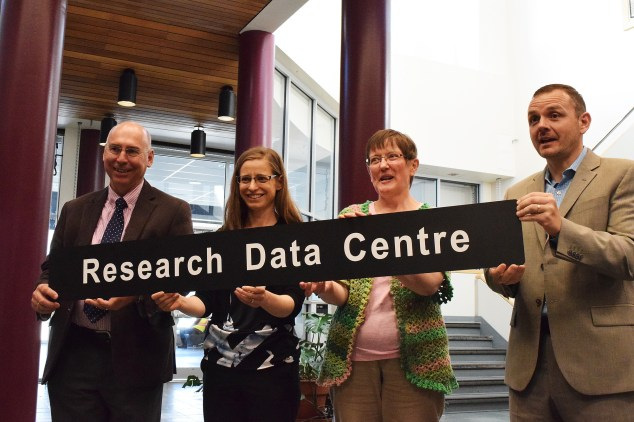 Dr. Paul Winwood, vice-president of the Northern Medical Program, Dr. Lisa Oliver, Statistics Canada regional manager, Dr. Cindy Hard, director of the UNBC Data Research Centre, and Dr. Geoff Payne, UNBC vice president research and graduate programs, officially open the UNBC Data Research Centre. Bill Phillips photo