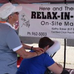 Kathy Baker delivers a soothing massage for one lucky patron at the downtown Farmer's Market Saturday. Bill Phillips photo