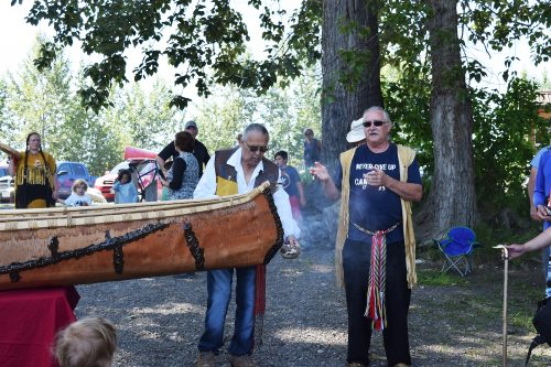 Earl Henderson smudges the canoe prior to it being launched. Bill Phillips photo