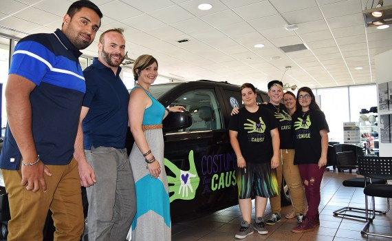 Hub City Volkswagen controller Sunny Brar (left), Richard and Sarah Schleich of Hub City Volkswagen along with Demmy and Renee Conway-Grist and Costumes for a Cause volunteers with the charity new vehicle. Bill Phillips photo