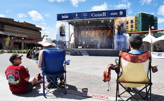 Spectators enjoy the Zavan Trio, performing as part of Heatwave at Canada Games Plaza Tuesday. Bill Phillips photo