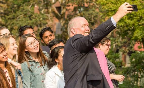 Premier John Horgan takes a selfie with Camosun College students. Government of B.C. photo