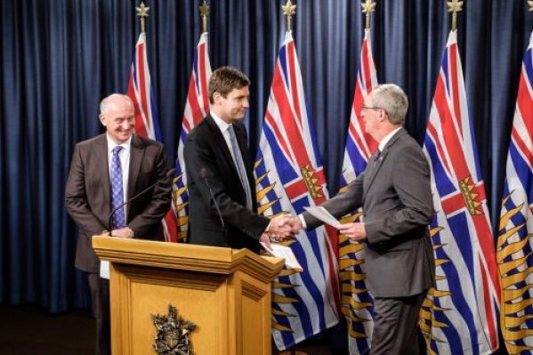 Ron MacDonald (right) is congratulated on becoming the new head of the Independent Investigations Office by Attorney General David Eby while Mike Farnworth looks on. Province of B.C. photo