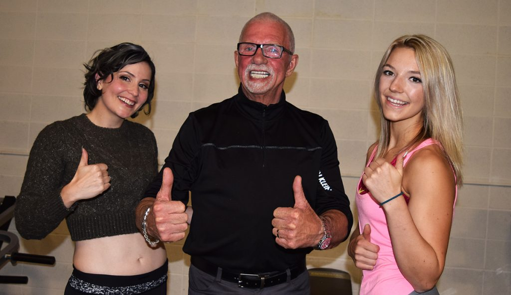John Brink, of the Brink Group of Companies - title sponsor for the Iron Ore Classic, with two Iron Ore competitors Sarah Schleich (left) and Devon Gyselinck. Bill Phillips photo