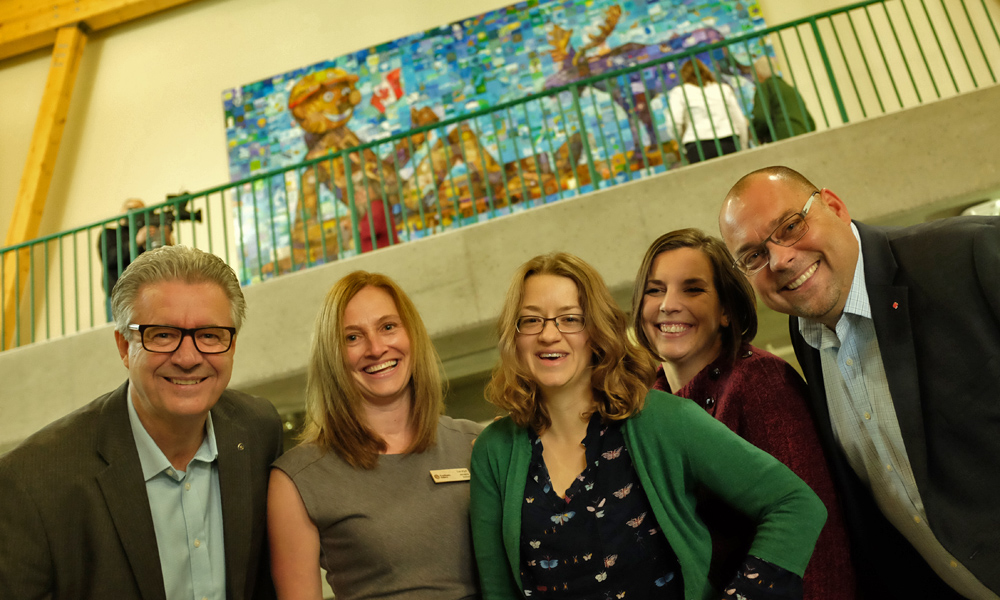 Twylla Exner (centre) helped coordinate the Canada 150 Mural project through the Two Rivers Gallery. Pictured with her (left to right) are Mayor Hall, Carolyn Holmes of the Two Rivers Gallery, Jen Tkachuk of the City, who coordinated Prince George's Canada 150 events, and MP Todd Doherty. City of Prince George photo