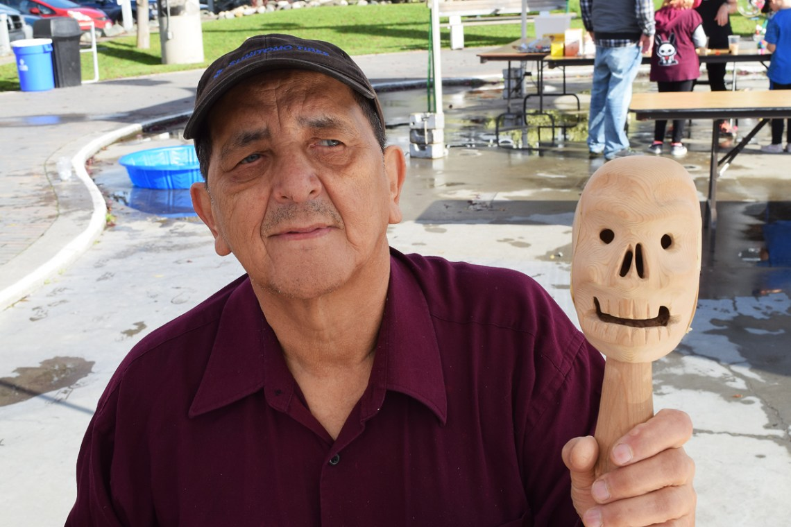 Leonard Paquette Jackson shows off a skull rattle he carved out of wood at the Mini Maker Faire Saturday. Jackson is the Maker in Residence at Two Rivers Gallery. Bill Phillips photo