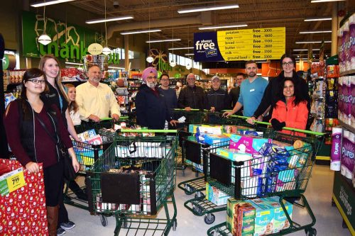 With shopping carts full with items for the Salvation Army, it's time to head to the check out.