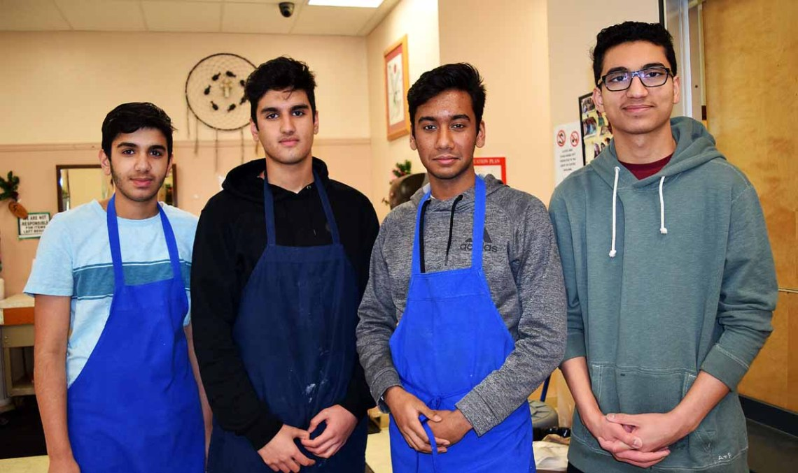College Heights Abdulghani Khan (left), Abullah Khan, Mahim Chowdhury, and Rayan Ahmed volunteered their time to help out at St. Vincent de Paul Thursday. Bill Phillips photo