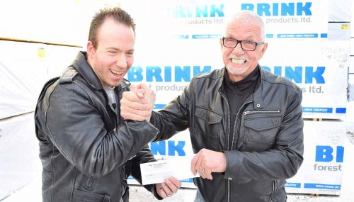 John Brink of the Brink Group of Companies presents armwrestler Dan Gallo with a $500 sponsorship. Bill Phillips photo
