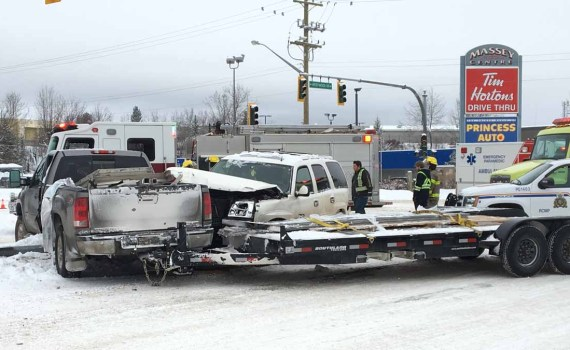 Traffic was snarled near Massey Drive and Westwood at lunchtime Friday as emergency crews cleared up a two-vehicle crash involving an SUV and a truck pulling a trailer. It's not known at this time if anyone was injured. Bill Phillips photo