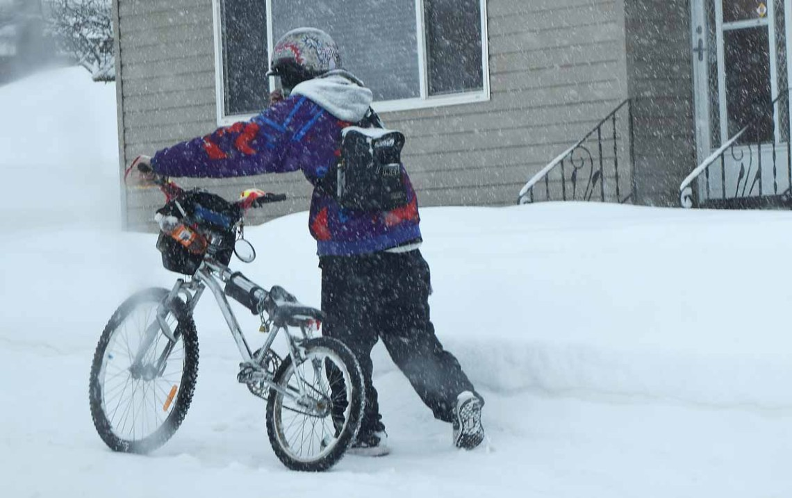 Perhaps rethinking the decision to take his bike this morning, this cyclist was spotted making his way through the heavy snow this morning near Fifth Avenue and Ahbau Street. Bill Phillips photo