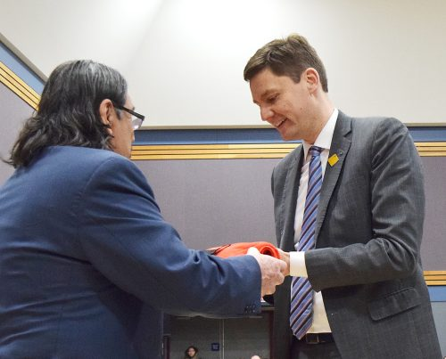 Prince George Elders Justice Council member Marcel Gagnon presents Attorney General Micheal Eby with a blanket to commemmorate the opening of the Prince George Indigenous Court. Bill Phillips photo