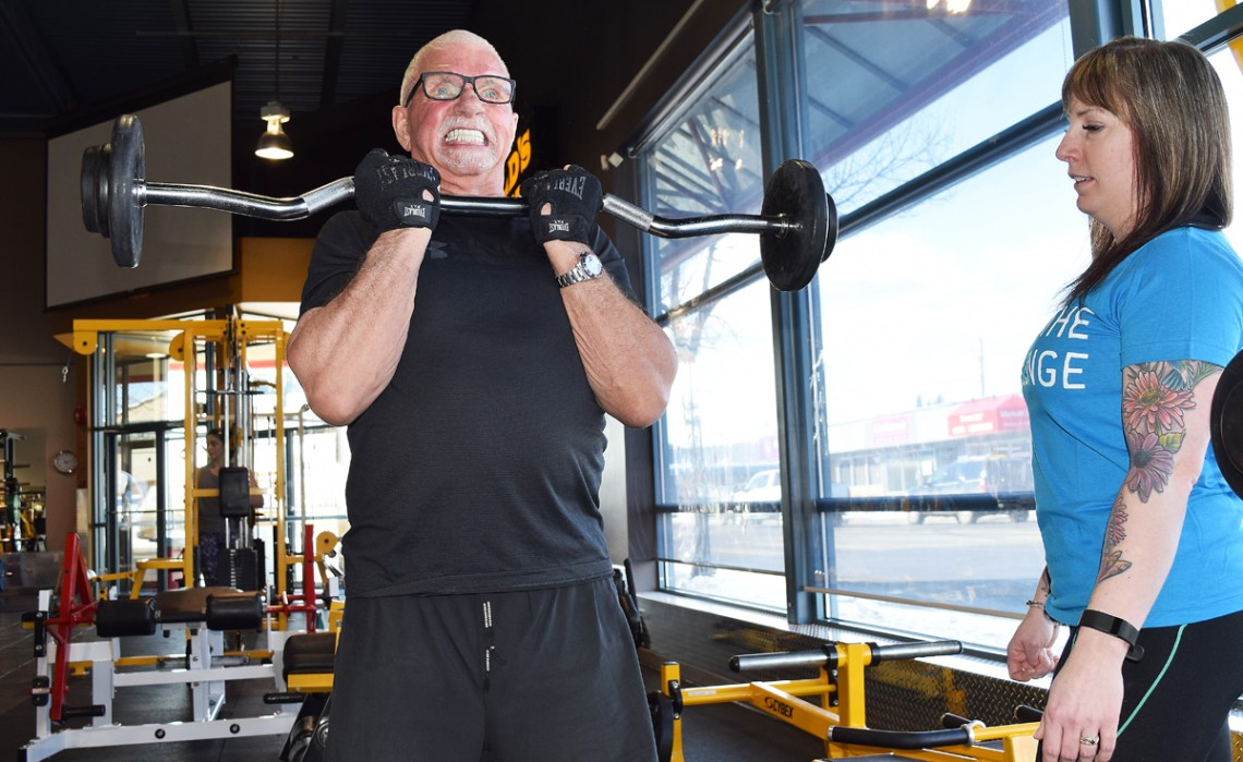 Trainer Karley Green puts John Brink through his paces as he trains for the bodybuilding provincials in July and the Iron Ore Classic in September. Bill Phillips photo