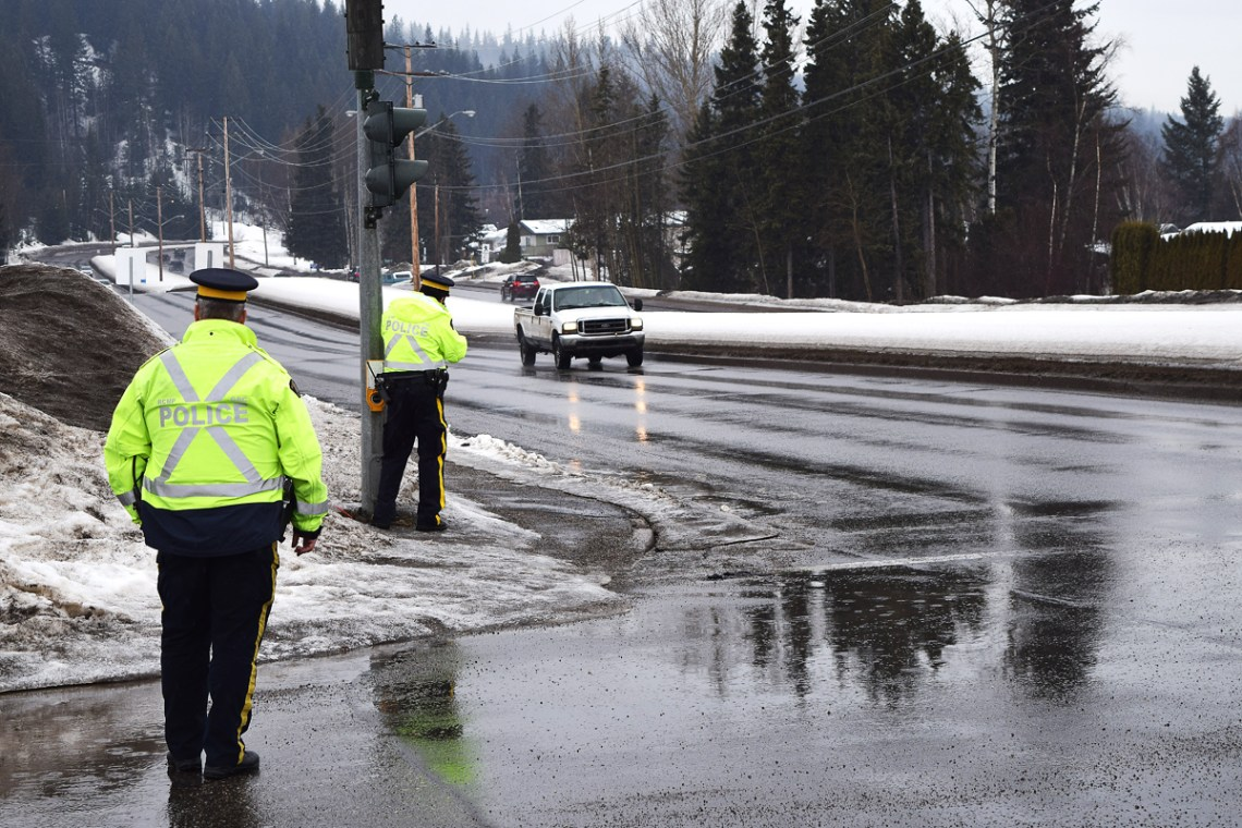 Members of the RCMP municipal traffic section check for distracted drivers and speeders along Foothills Boulevard. Bill Phillips photo