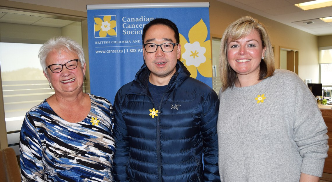 Helen Owen (left) and Amiee Cassie of the Canadian Cancer Society are all smiles as Austin Kim of the PG Recycling and Return-it Centre announces residents can donate to the Relay for Life with their recyclables. Bill Phillips photo