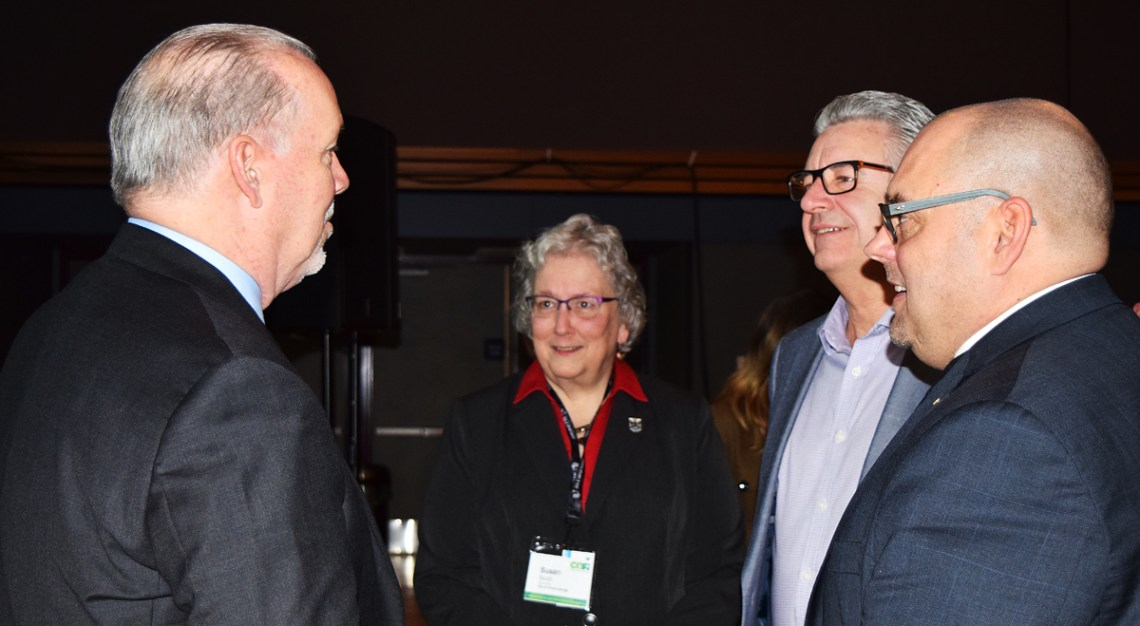 Premier John Horgan chats with Prince George Coun. Susan Scott, Mayor Lyn Hall, and Cariboo-Prince George MP Todd Doherty at the annual COFI convention Friday. Bill Phillips photo