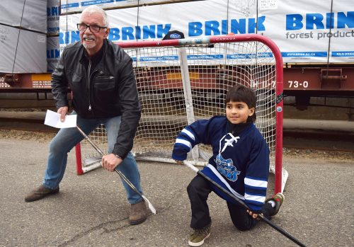 John Brink of the Brink Group of Companies and Sunjai Sharma are ready for the big game. Bill Phillips photo