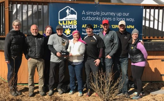 "Climb for Cancer Committee members and Chair David Duck presents the Kordyban Cup to Maureen Cox of the ""Winers"" for being the top fundraising team. She accepted the Cup on behalf of her husband, Richard, who was team captain. Maureen was awarded the Spirit award as well. Submitted photo"