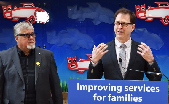 Acting Northern Health board chair Frank Everitt (left) watches as Health Minister Adrian Dix talks about increasing hip and knee surgeries in the North. Bill Phillips photo